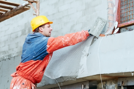 stucco facade: Builder at facade plastering works