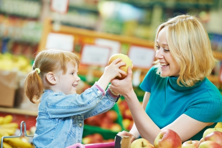 grocery: woman and little girl shopping fruits