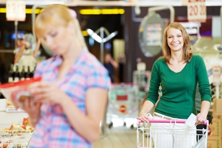 women at supermarket shopping Stock Photo - 14081891