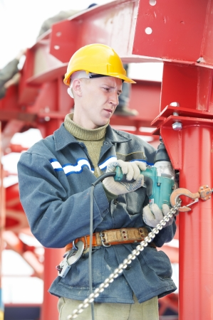 millwright: builder worker assembling metal construction Stock Photo