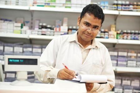 Pharmacy chemist in drugstore