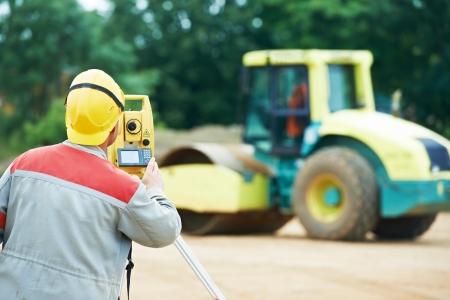 surveyor works with theodolite Stock Photo - 14472628