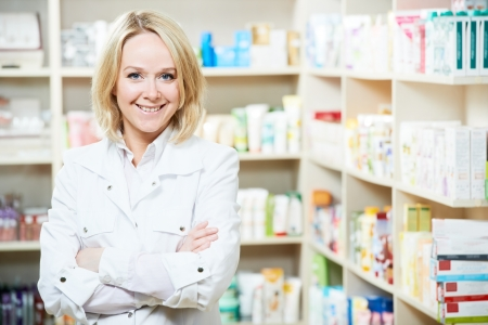 pharmacy store: Pharmacy chemist woman in drugstore Stock Photo