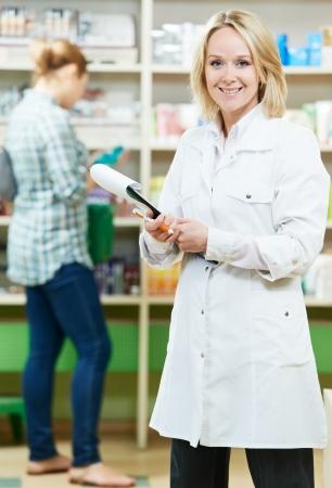 Pharmacy chemist woman in drugstore Stock Photo - 14472626