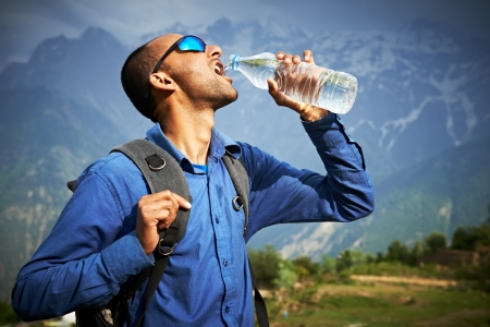 sportsman: thirsty tourist drink a water