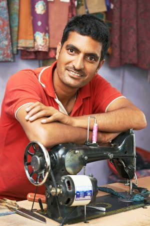 Indian man tailor portrait photo