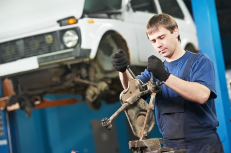 auto mechanic at work with wrench spanner photo