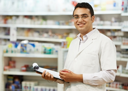 druggist: Pharmacy chemist woman in drugstore Stock Photo