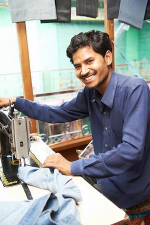 textile machine: Indian man tailor portrait