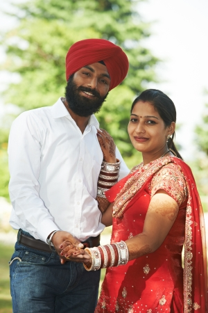 Happy indian young adult married couple photo