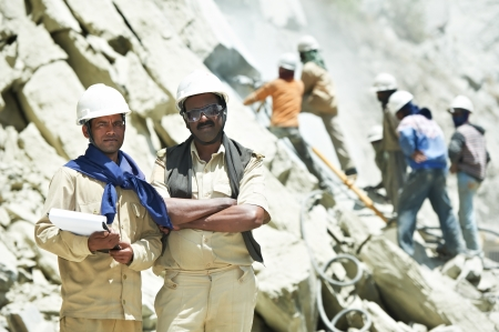 Hindu indian builders workers at construction site photo