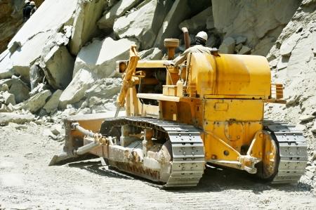 track-type loader bulldozer excavator at road work photo