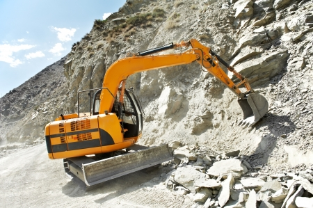 track-type loader excavator at mountain work photo