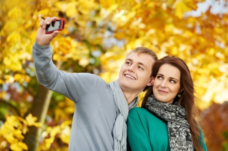 Couple at autumn outdoors photo
