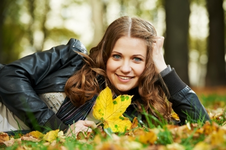 Woman at autumn outdoors photo