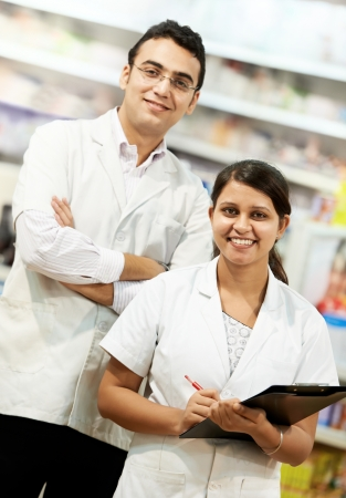 Two Pharmacy chemist in drugstore photo