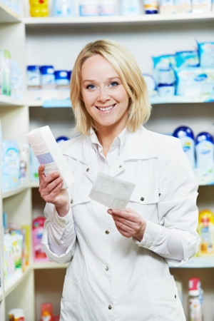 Happy Pharmacy chemist woman in drugstore photo
