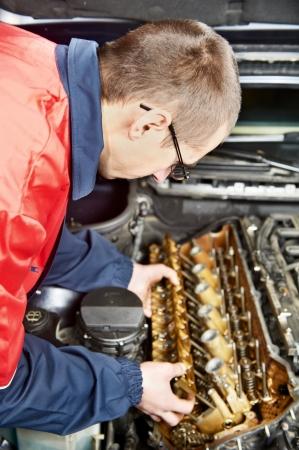 machinist: mechanic repairman at automobile car engine maintenance repair work Stock Photo