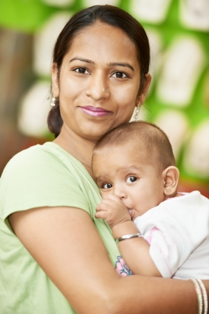 Happy smiling Indian woman mother hugging her little child boy photo