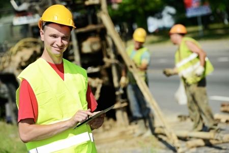 surveyor: One happy smiling engineer site manager builder with tablet PC at geology roadwork construction site Stock Photo