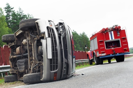 safe driving: Reversed automobile car laying on country road after accident crash