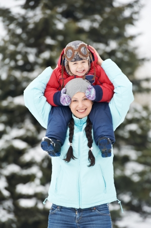 endearment: Mother with child boy son at winter