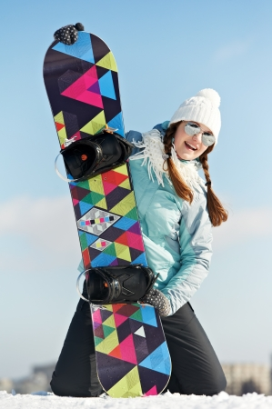 snowboard: Happy sportswoman with snowboard Stock Photo