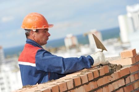 bricklayer: construcci�n alba�il alba�il trabajador Foto de archivo