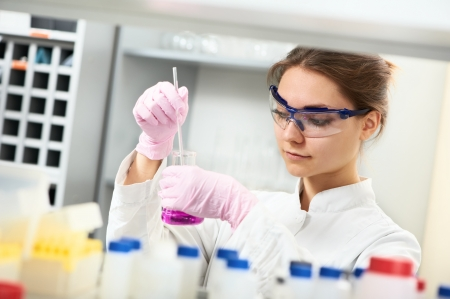 One female scientist researcher making research in chemistry laboratory Stock Photo - 21769522