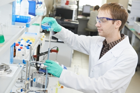 One male scientist researcher making research in chemistry laboratory photo