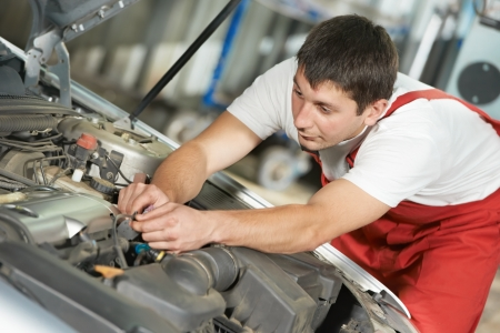 motor mechanic: auto mechanic at work