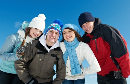 snow drift: group of happy young people in winter Stock Photo