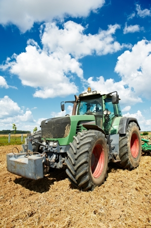 Ploughing tractor at field cultivation work Stock Photo - 15809283