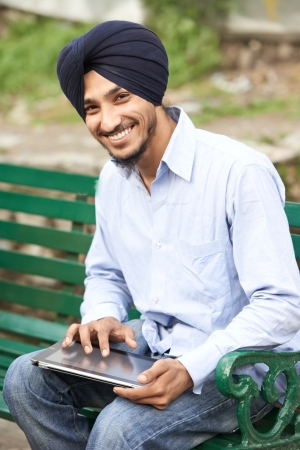 Young adult indian sikh man photo