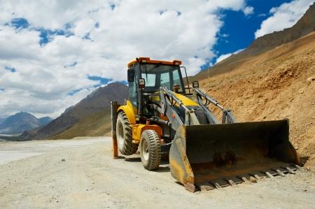 roadwork: wheel loader excavator machine doing ready to earthmoving roadwork at india mountains