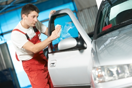 car glass: auto service cleaner washing car Stock Photo