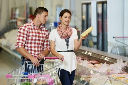 grocery shopper: Family at food shopping in supermarket Stock Photo