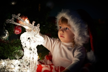 x mas: little girl with gifts at Christmas or new year
