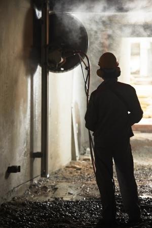 taskmaster: builder worker operating demolition machine