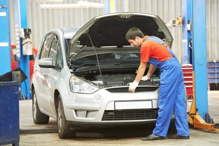 Repairman auto mechanic at work  photo