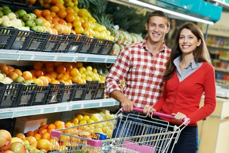 woman shopping cart: Family at food shopping in supermarket Stock Photo