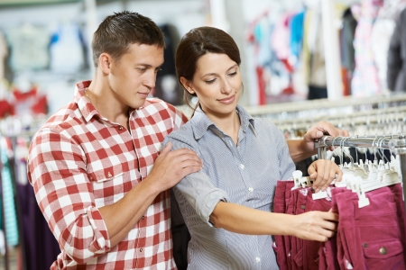 Young family at clothes shopping store photo