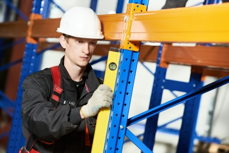 inspecting: warehouse installer worker examining quality