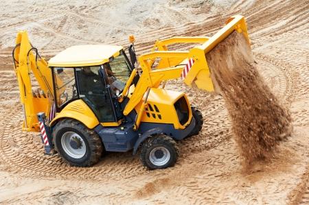 backhoe: Excavator Loader at earth moving works