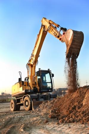 sand quarry: track-type loader excavator at work