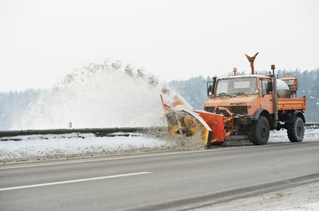 snow plow: Winter road snow removal Stock Photo