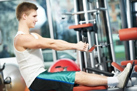 man doing back exercises at fitness gym photo