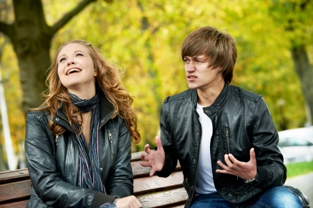 faithlessness: young couple in stress relationship
