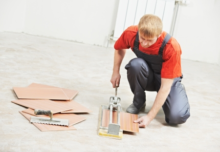tiler cutting tile at home renovation work photo