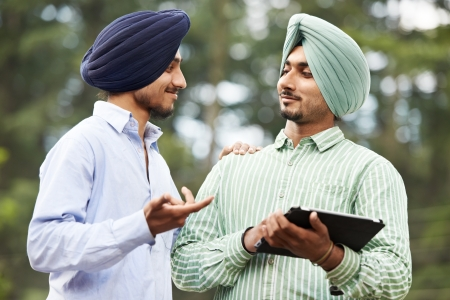 sikh: Young adult indian sikh men
